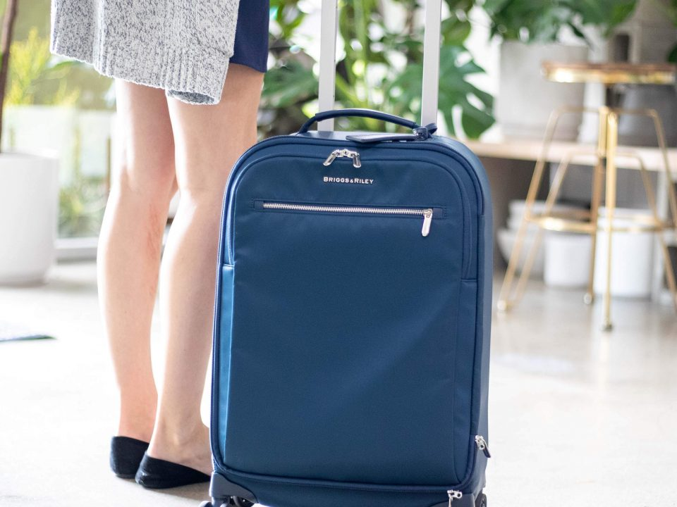 Woman with Briggs & Riley Luggage
